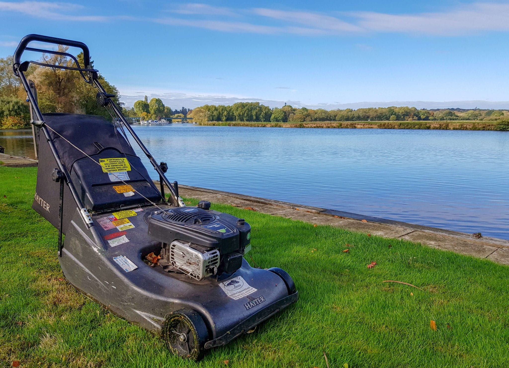 Lawnmower in front of lake